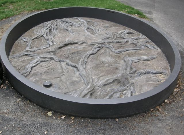 'Roots' - fountain with relief in concrete, 2008. (photographed without water). Elisabethenpark, Basel.